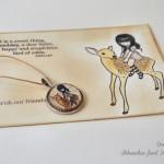 Razglednica in medaljonček Gorjuss na srnici