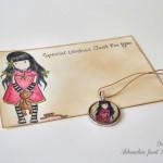 Razglednica in medaljonček Gorjuss z medvedkom